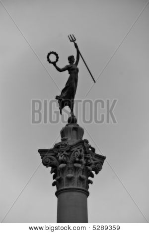 Statue Of Woman Holding Pitchfork