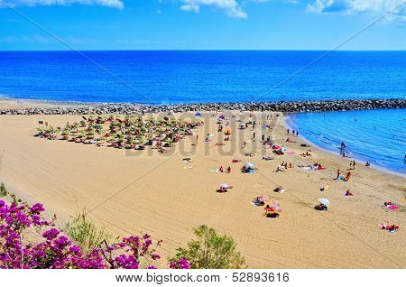 MASPALOMAS, SPAIN - OCTOBER 9: Playa del Ingles beach on October 9, 2013 in Maspalomas, Gran Canaria, Canary Islands, Spain. This is an important winter tourist destination for many europeans