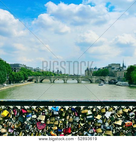 Love padlocks in the Pont des Arts bridge and the Seine River facing the Pont Neuf in Paris, France
