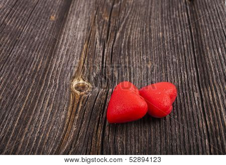 Two Red Heart Candies on crack break wood texture background, valentines day card concept