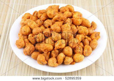 Spiced coated fried peanut.