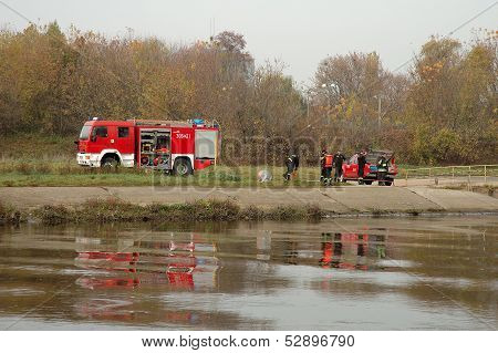 Fire Brigade Exercises On River Bank