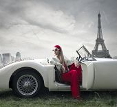 beautiful woman on a vintage car in Paris
