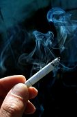 picture of cigarette-smoking  - A smoking cigarette - JPG