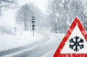 stock photo of chains  - Sudden and heavy snowfall on a country road - JPG
