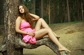stock photo of 16 year old  - Teen girl 16 years old Caucasian appearance in a pink dress rest on the nature in a pine forest - JPG