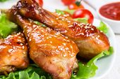 stock photo of sesame seed  - Fried chicken legs with teriyaki sauce and sesame seeds - JPG