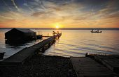 picture of dock a lake  - A beautiful autumn sunrise on the pebbled shores of Lake Cayuga in the Finger lakes region of New York state - JPG