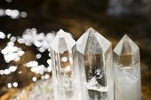 stock photo of quartz  - Quartz crystal aligned at the glitter riverside - JPG