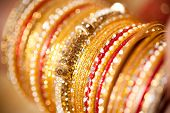 pic of bangles  - bridal decorative gold diamond bangles in hand during festival or party - JPG