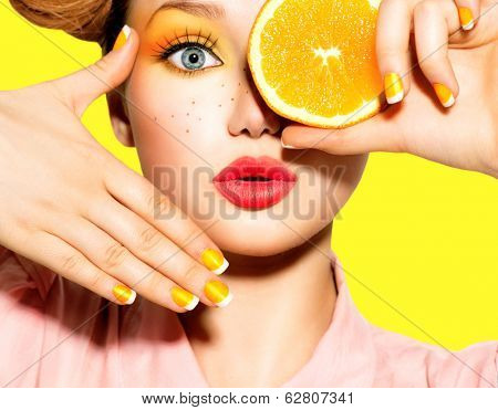 Beauty Model Girl takes Juicy Oranges. Beautiful Joyful teen girl with freckles, funny red hairstyle poster