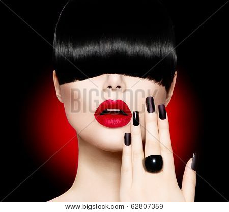 High Fashion Model Girl Portrait with Trendy Hair style, Make up and Manicure. Long Black Fringe Hairstyle, Black Matte Nail Polish and Red Matte Lipstick. Woman Makeup. Sexy Lips. Haircut