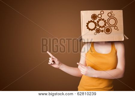 Young woman standing and gesturing with a cardboard box on his head with spur wheels