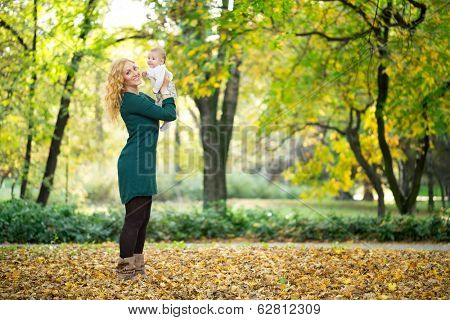 Mother and baby having fun in park