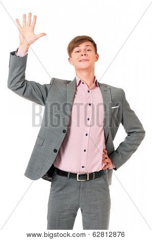 Smiling young man greets with his hand, isolated on white background
