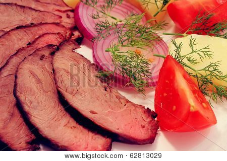 grilled beef meat steak with fried potatoes and tomatoes on white plat