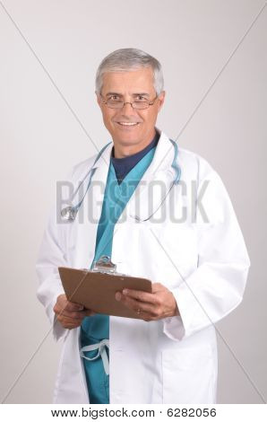 Doctor In Scrubs And Lab Coat With Clipboard