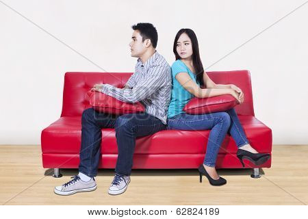 Couple Sitting Back To Back After A Fight