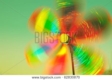 rotating colorful pinwheel outdoor shot retro colors