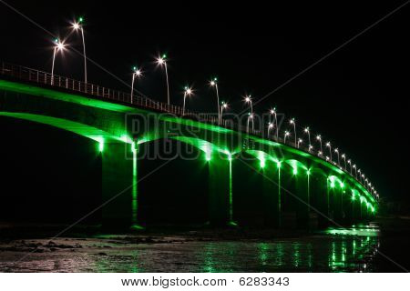 Viaduct under green lights