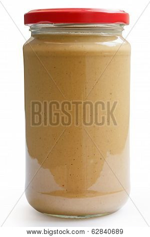 Closed glass jar of crunchy peanut butter