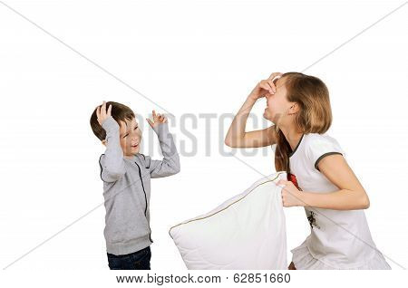 Laughing Boy And Girl Fighting Pillow