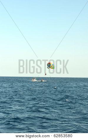 Parachute on blue sea