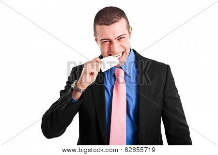 Angry businessman biting a business card