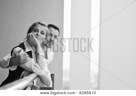 Romantic happpy couple on balcony