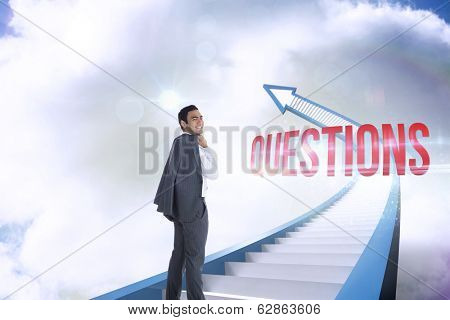 The word questions and smiling businessman standing against red staircase arrow pointing up against sky