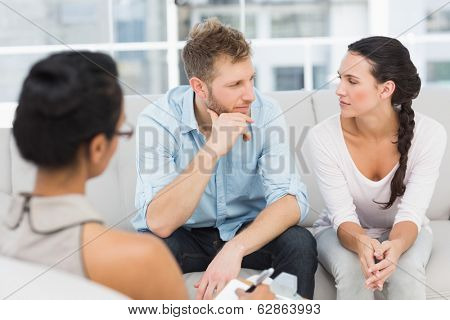 Unhappy couple at therapy session in therapists office