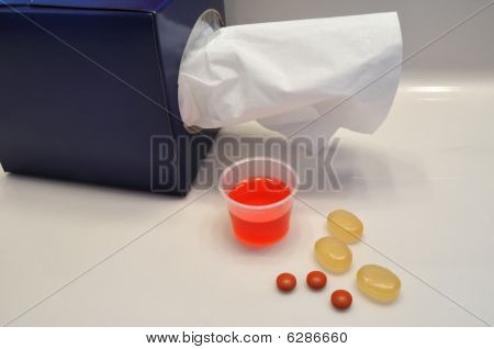 Tissues, Cough Syrup, Throat Lozenges, And Ibuprofen