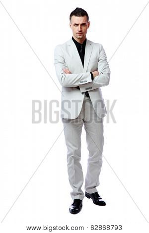 Full-length portrait of a businessman standing with arms folded isolated on a white background