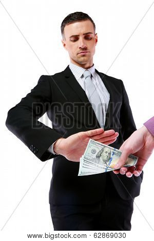 a uncorrupted businessmen refusing money from a bribe isolated on a white background