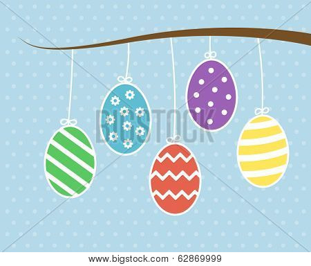 Easter eggs hanging on tree