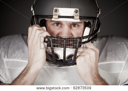 American football player  on the uniform, studio shoot