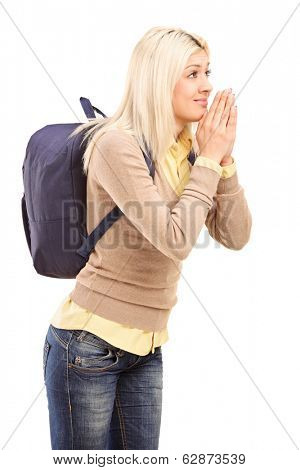 College girl eagerly anticipating something isolated on white background