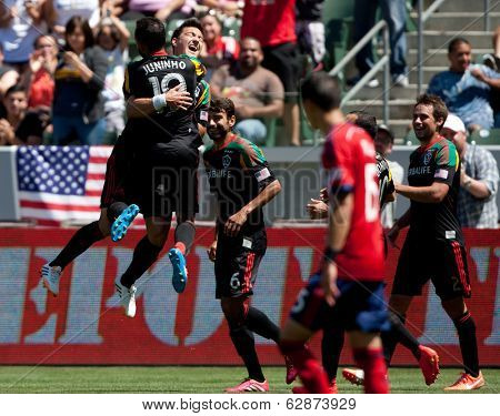 CARSON, CA - APRIL 6: Los Angeles Galaxy M Stefan Ishizaki (24) celebrates during the MLS game between the Los Angeles Galaxy & Chivas USA on April 6th 2014 at the StubHub Center.