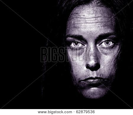 Closeup Portrait of a very disturbed Woman on Black