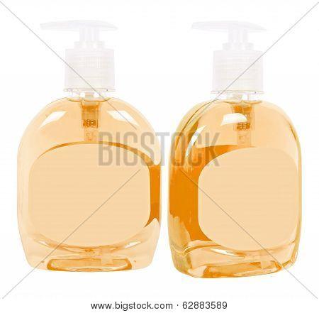 Orange Bottles With Liquid Soap