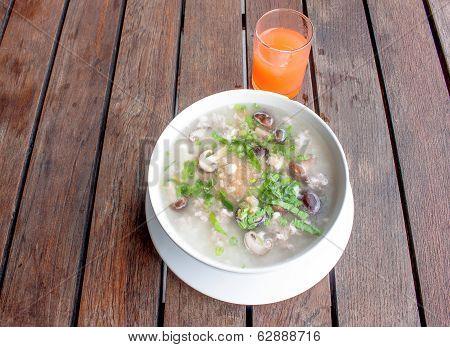 rice porridge breakfast  food on  table and orange juice