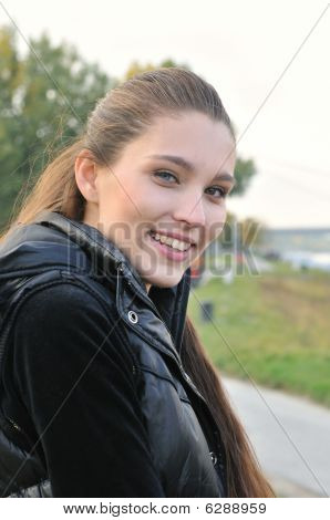 Portrait Of Young Smiling Woman Outdoors