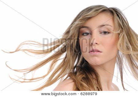 Portrait Of Young Woman With Flying Hair