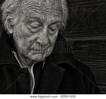 Outdoor Portrait of a senior man with Sadness