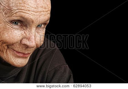 Nice Image of a peaceful Elderly Woman isolated on black