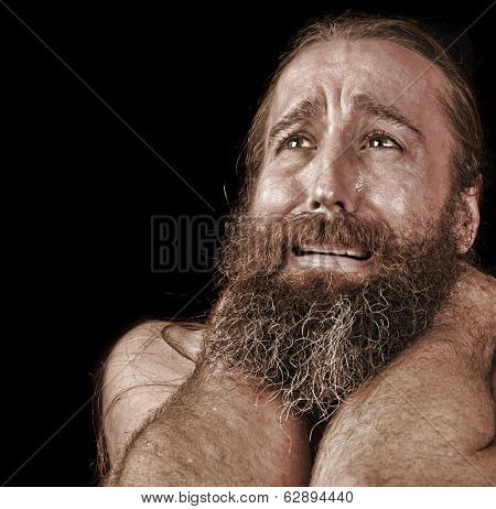 Very Emotional Image of a bearded Homeless man Crying