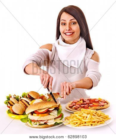 Woman eating fast food. Isolated.