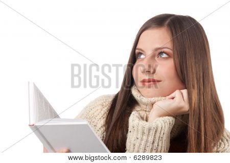 Portrait Of Young Happy Woman With Book