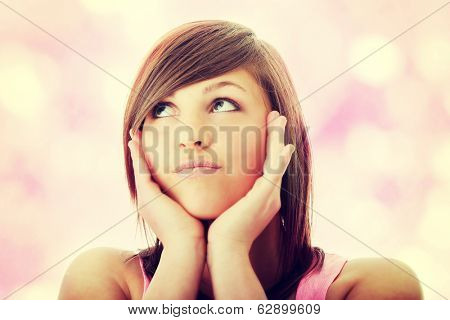 Young woman with expresion portrait - looking up