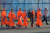 SOCHI, RUSSIA - FEBRUARY 12, 2014: Dutch fans in the colors of team Netherlands go to the competitio